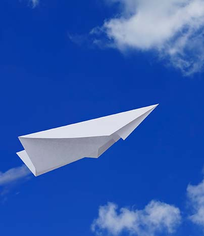 Paper plane flying in the sky